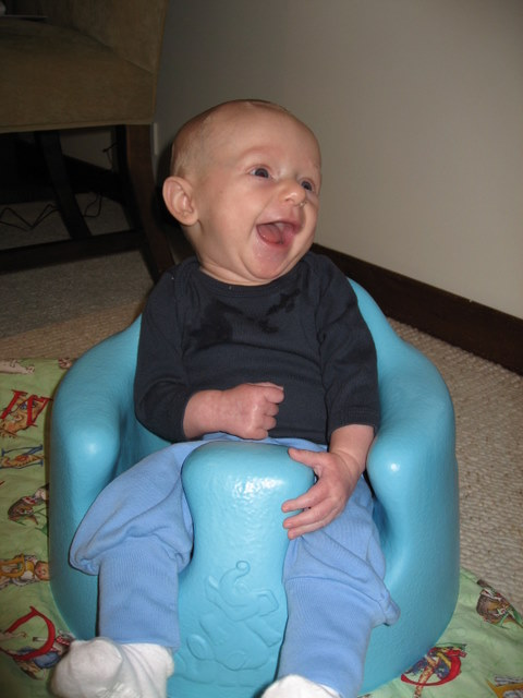 First time in his Bumbo chair…looks like he is riding a bucking bronco…it was just that fun!